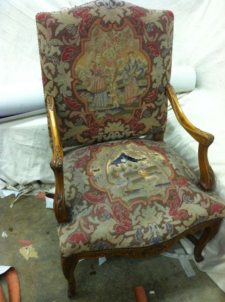 old ripped armchair