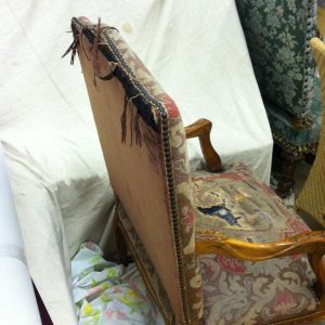 ripped armchair back