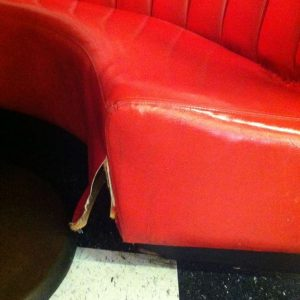 ripped red booth