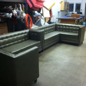 green corner booths in the shop 2