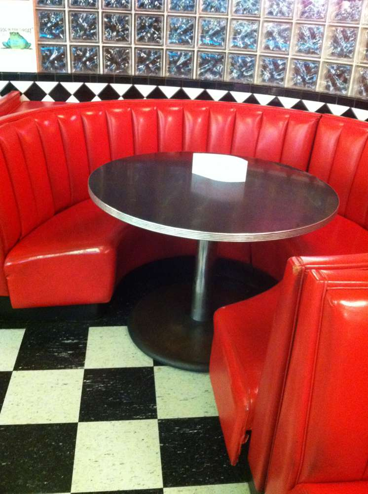 red round booth with round table